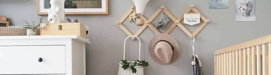 Nordic Scandi Nursery with expanding accordion coat rack on grey walls